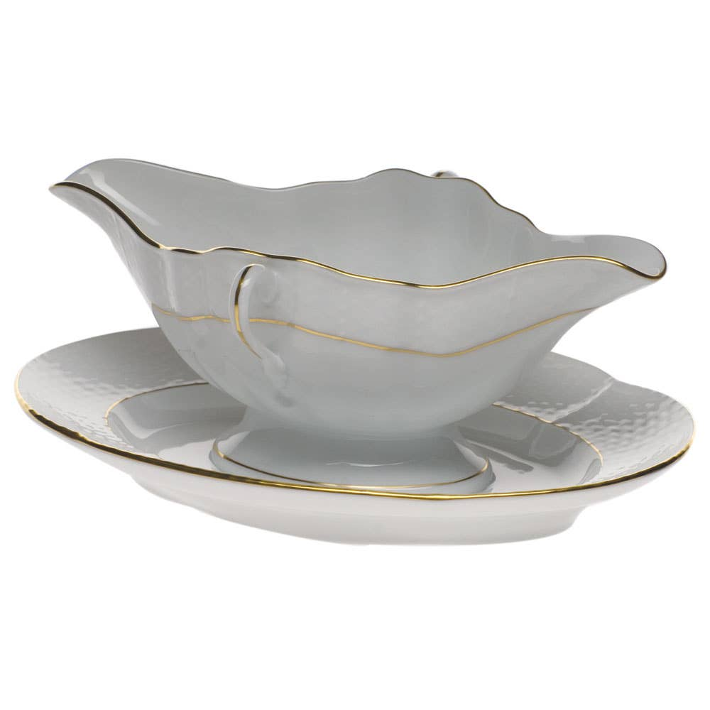 Gold-enlayed floral gravy boat with saucer attached made in USA