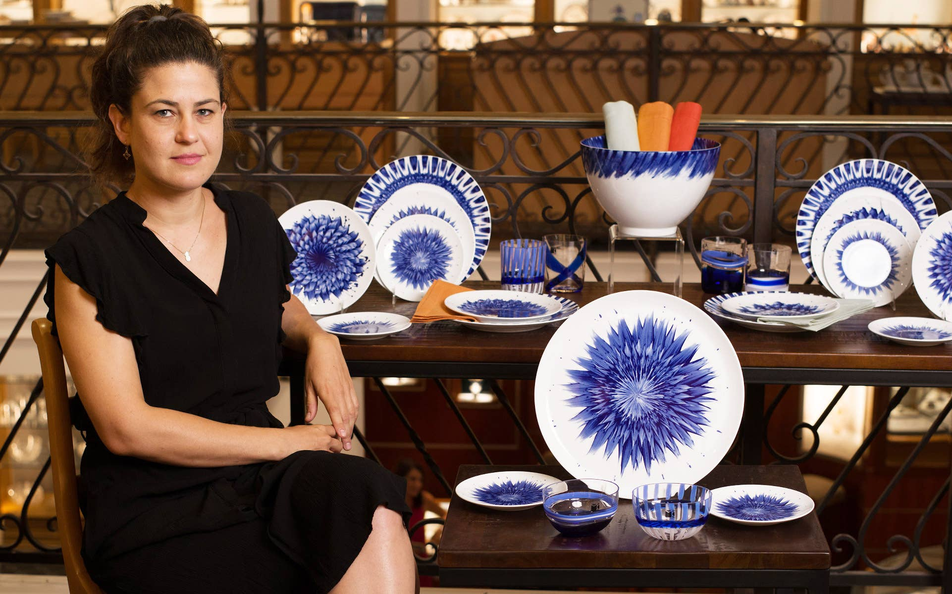 Zemer Peled posing at GEARYS Beverly Hills with her In Bloom collection for Bernardaud