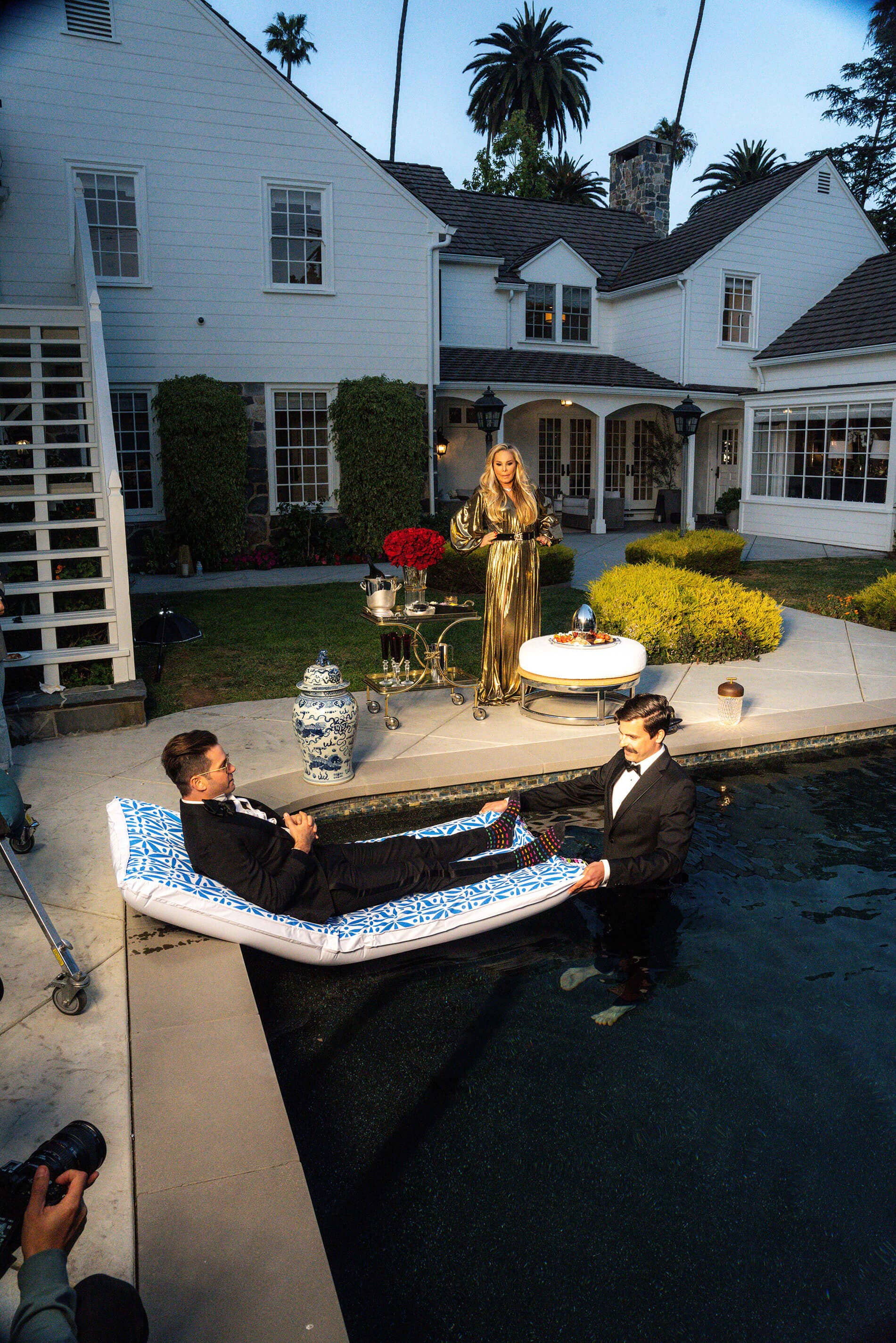 Josh Flagg and Adrienne Maloof at sunset by the pool