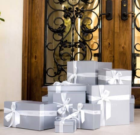 Registry Gifts in front of wrought iron gate door