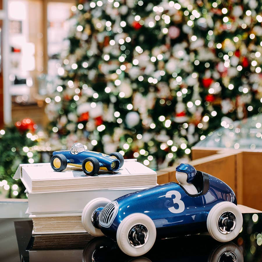 Children Toy Cars in Blue Near Christmas Tree
