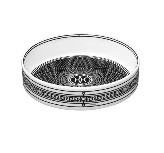 Intricate black and white spiral adorned wine coaster from Hermès H Déco collection