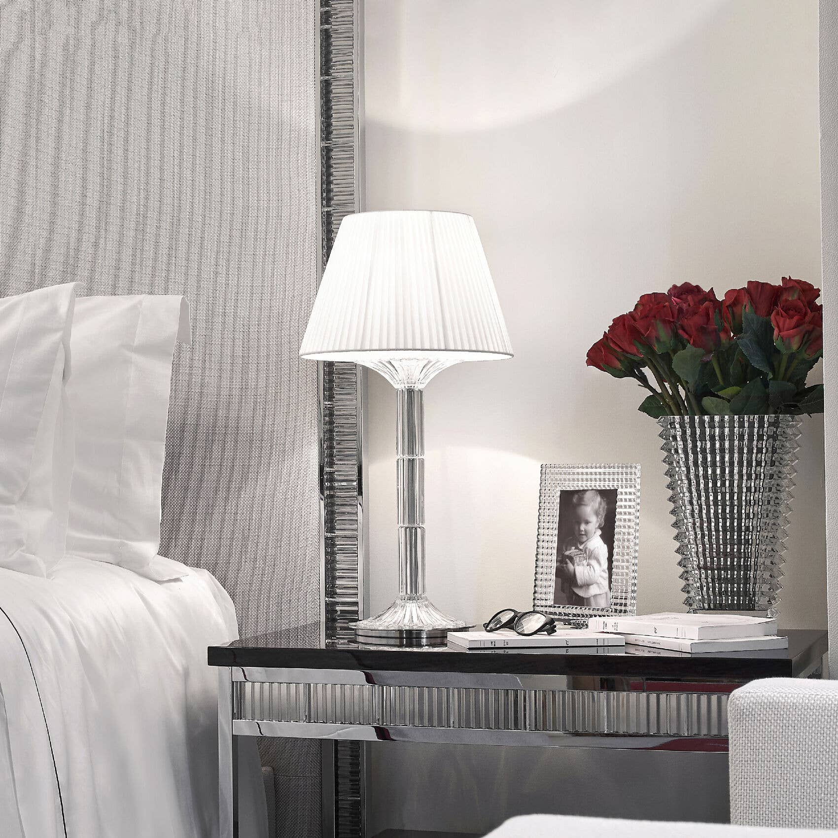 Mille Nuit lamp on night stand with signature Eye vase and frame
