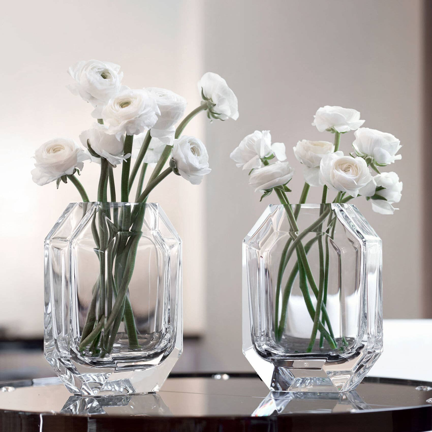 Baccarat Octogone vase in clear with white ranunculus flowers
