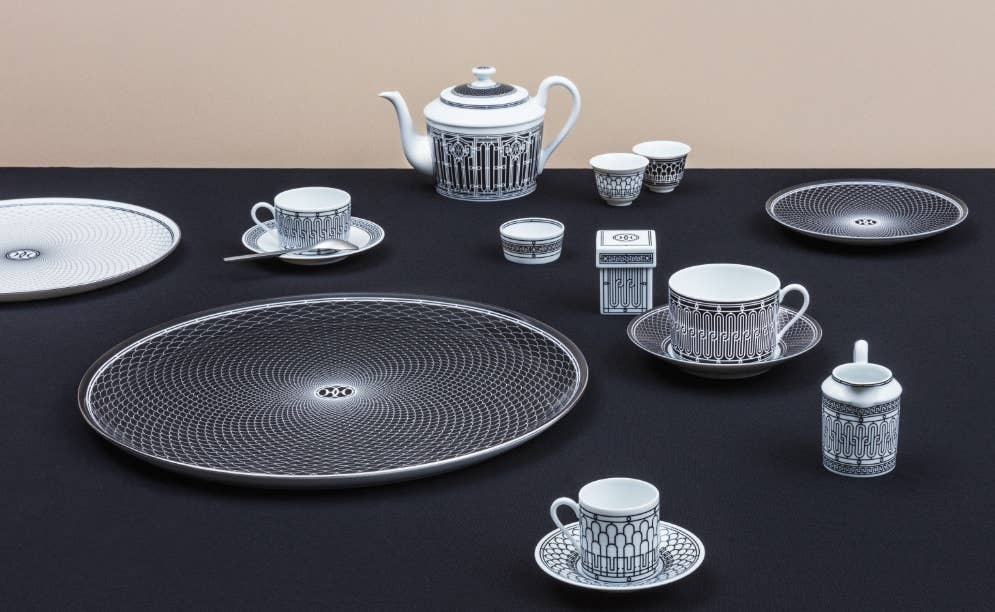 Intricate black and white spiral adorned tea service from Hermès H Déco collection